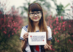 dress up a COSPLAY at cherry blossom field and take nice pictures holding a handwritten sign of your website or business small2