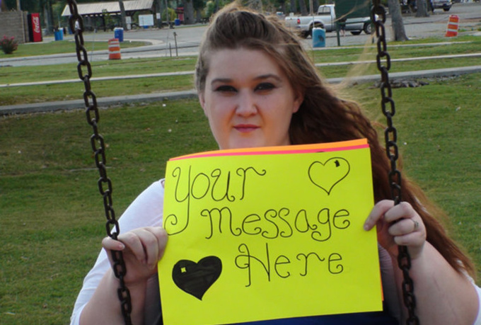 take 3 high resolution photos of my girlfriend holding a sign to promote your message
