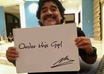 take a picture of Diego Maradona holding a sign of your website or business