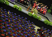 print and distribute flyers at the Duquesne University graduation